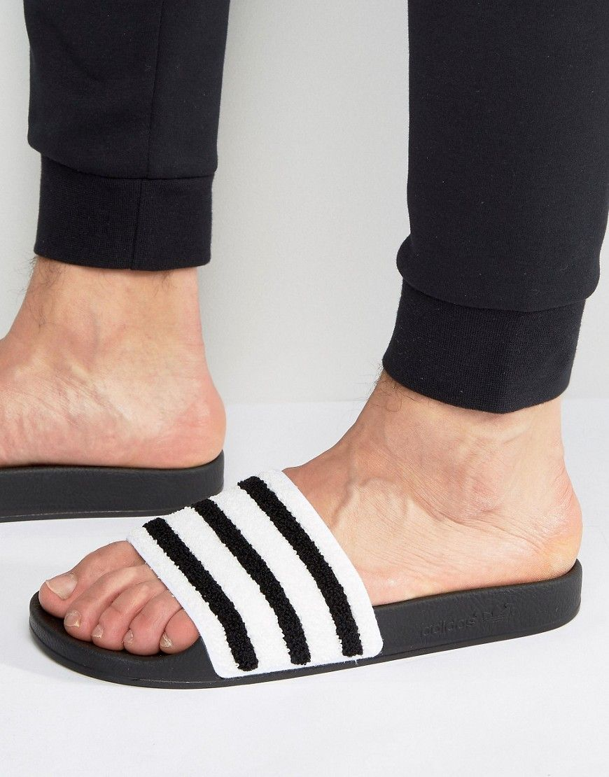 fcbaa3dc41fc20 ADIDAS ORIGINALS ADILETTE SLIDES IN BLACK TOWELING BB0125 - BLACK.   adidasoriginals  shoes