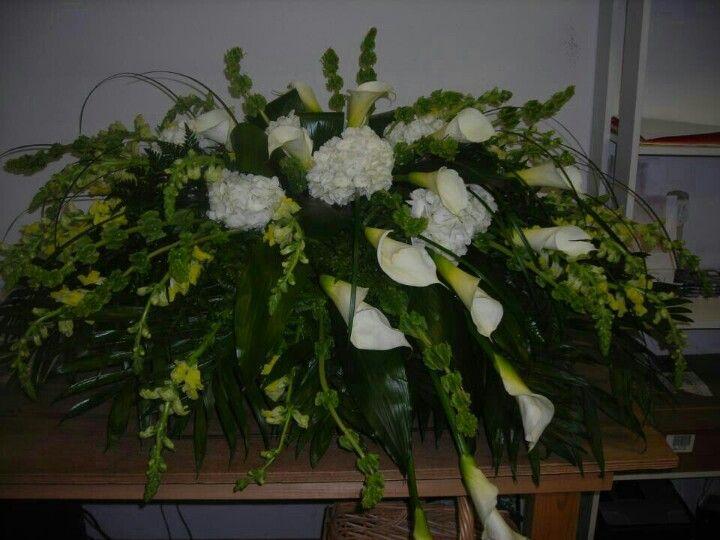 Modern Design Spray Of White Hydrangeas White Calla Lilies Green Bells Of Ireland Yellow Sna Funeral Flowers Funeral Flower Arrangements Flower Arrangements