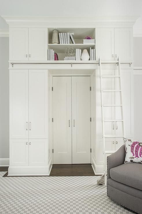 Playroom Loft Displaying Floor To Ceiling Storage Cabinets With A Ladder On Rail Custom Designed