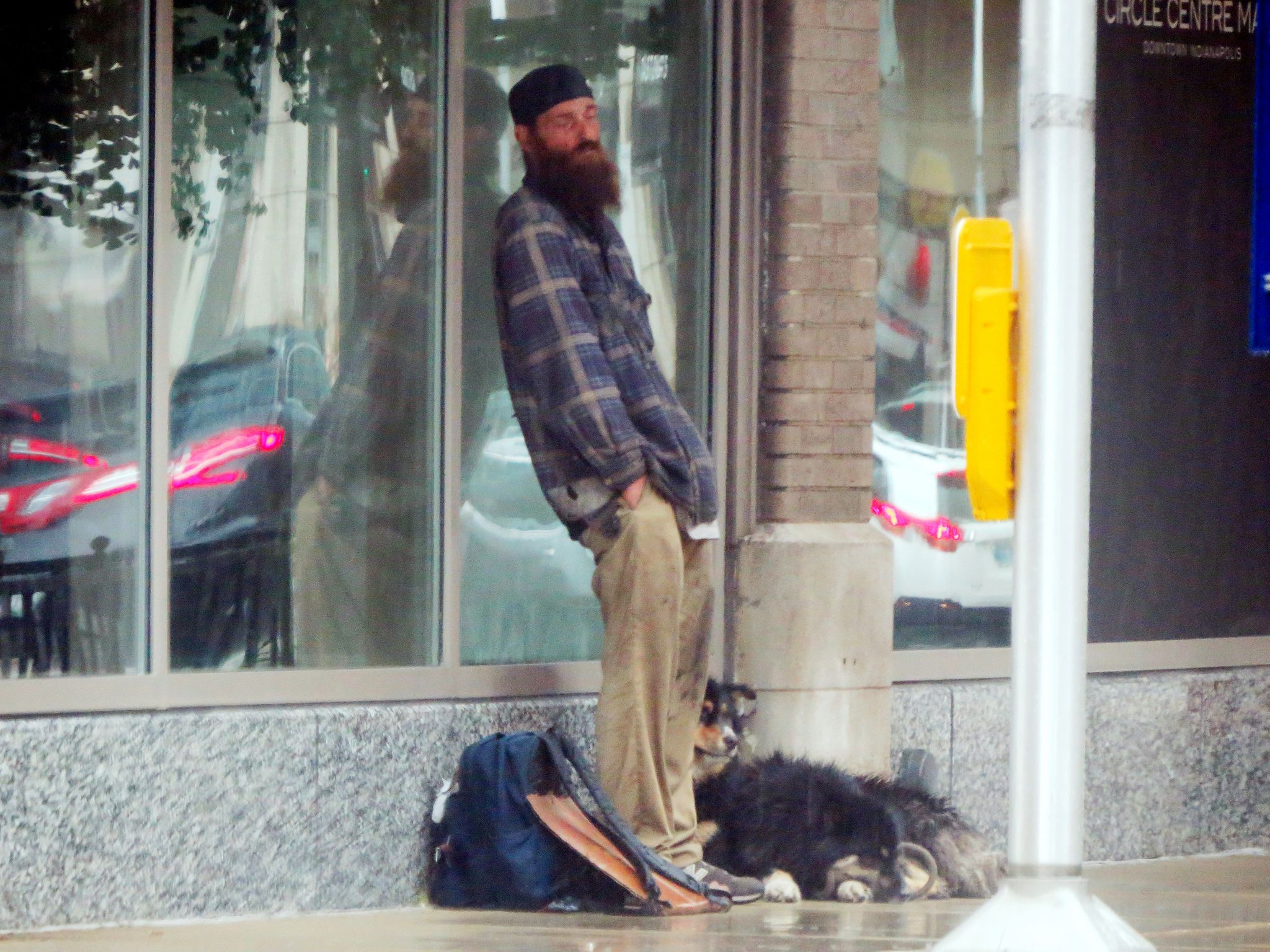 HomelessinINDY and waiting for the rain to stop. Rain