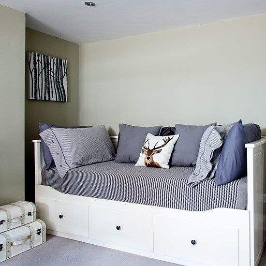 Grey guest bedroom with storage day bed