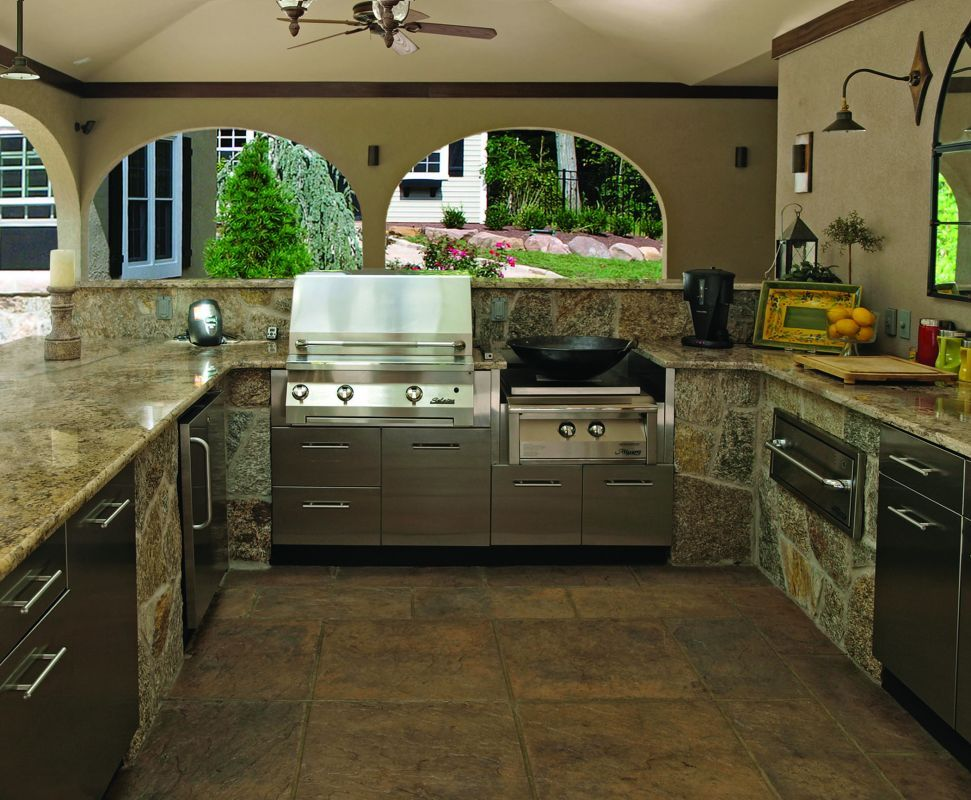 This kitchen features stainless steel slab doors to match the ...