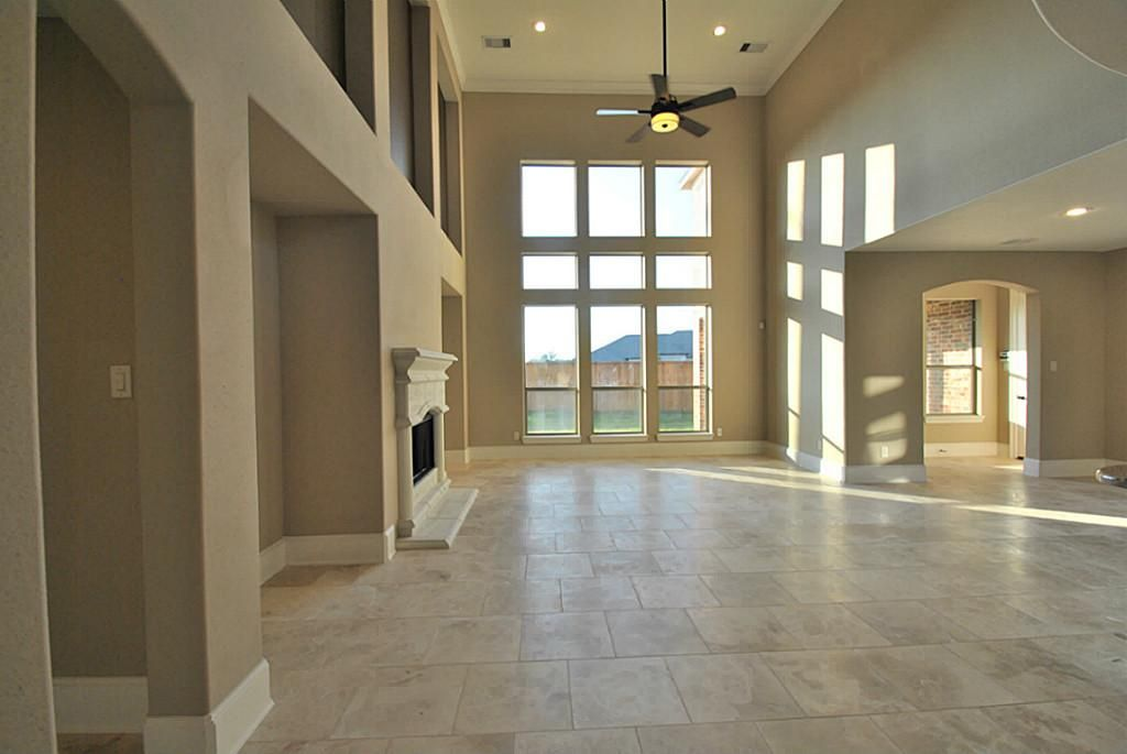 Elegant entry with a beveled glass front door, raised ceilings ...