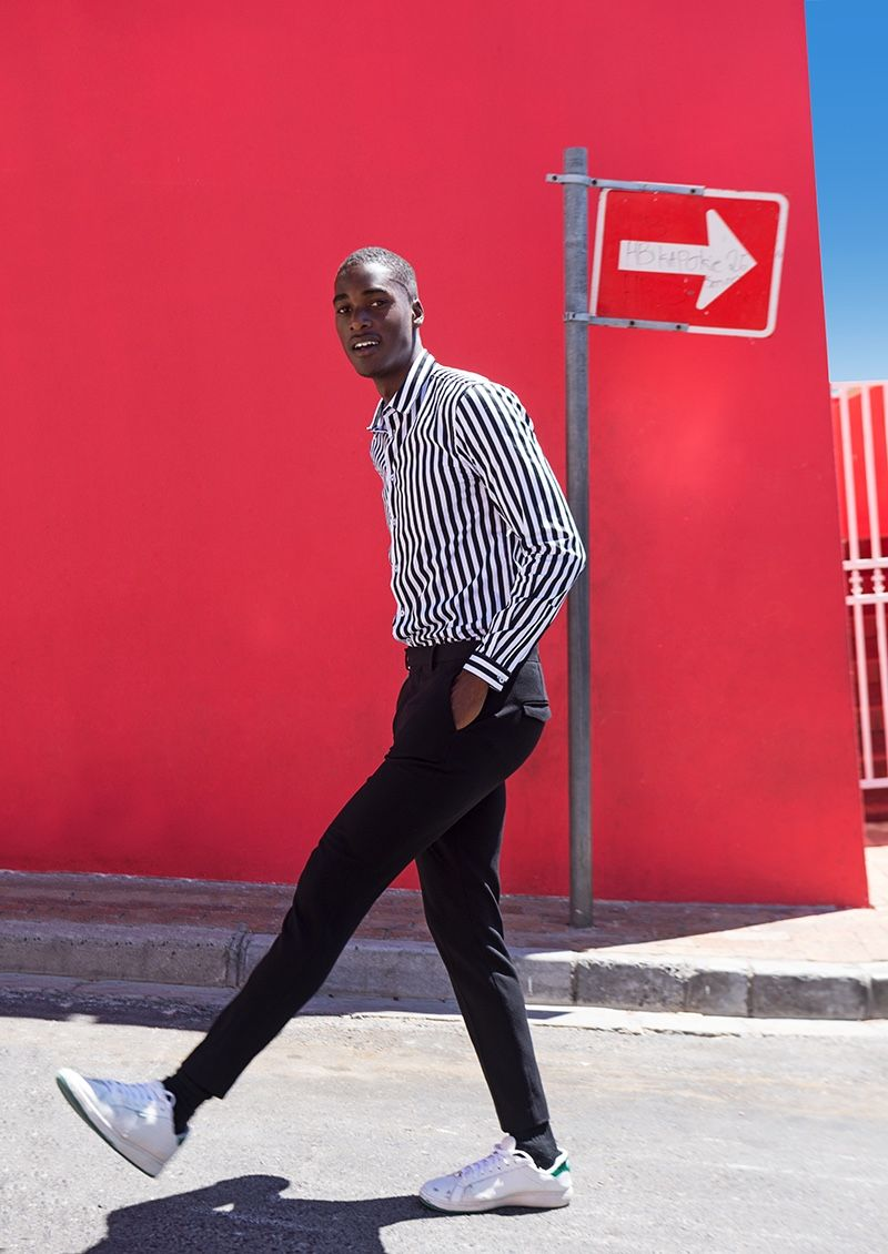 Gauderic wears striped shirt Chevignon, trousers Paul Smith, and shoes Prince.