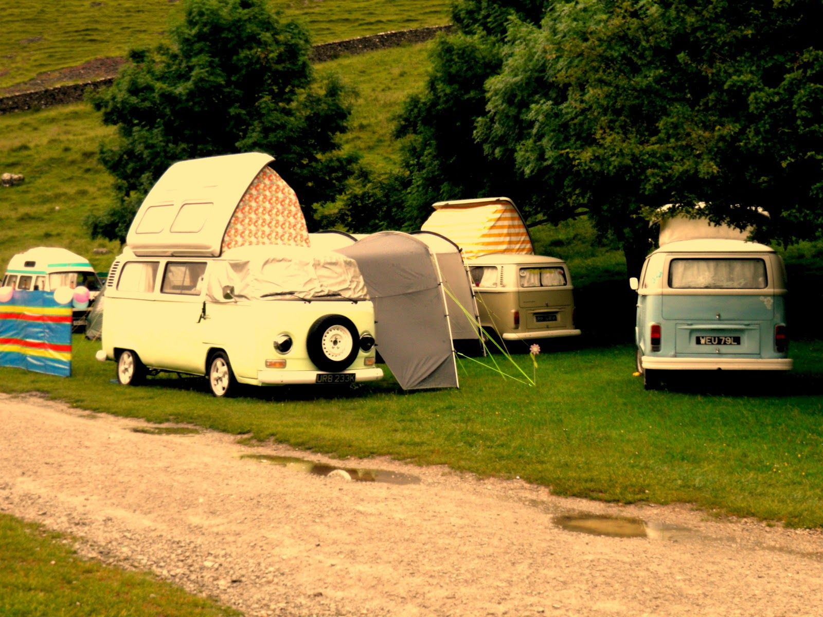 I'm not sure what type of camping vans these are, but I know that I really want and need one!  Image via Ruche from 3/16/2012.