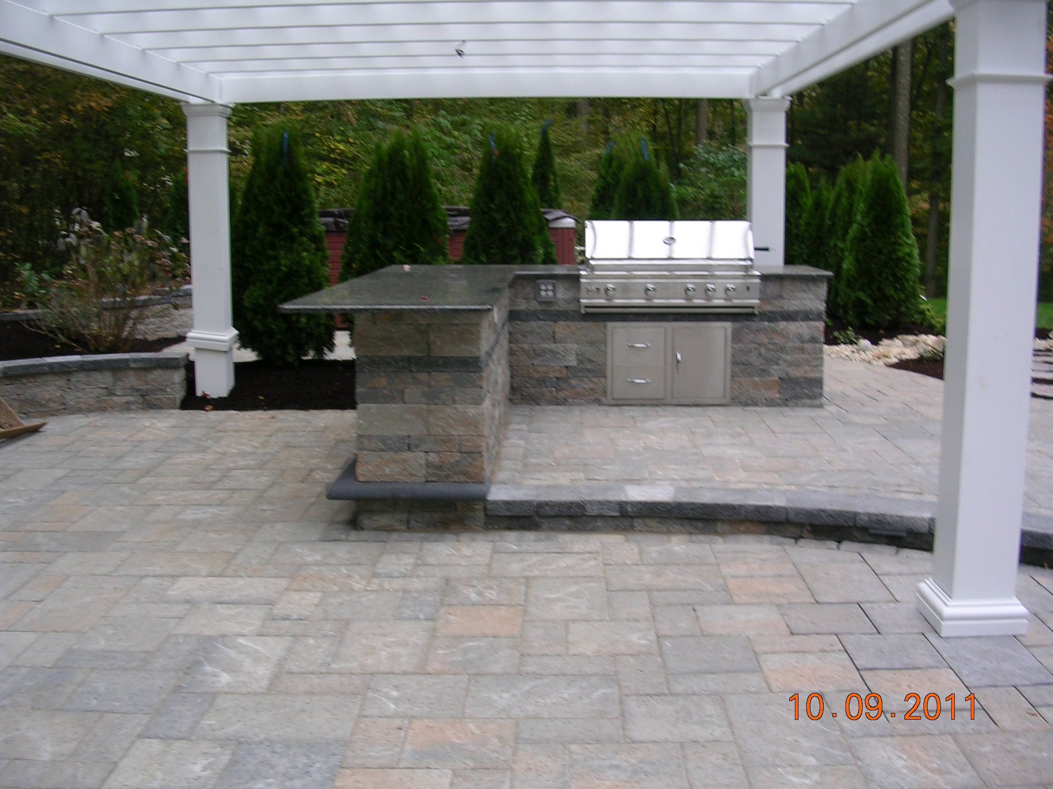 Outdoor Kitchen And Bar With Stainless Steel Grill And Pergola Set On A Paver Patio By Bahler Brothers In Hebron Outdoor Kitchen Outdoor Kitchen Island Patio