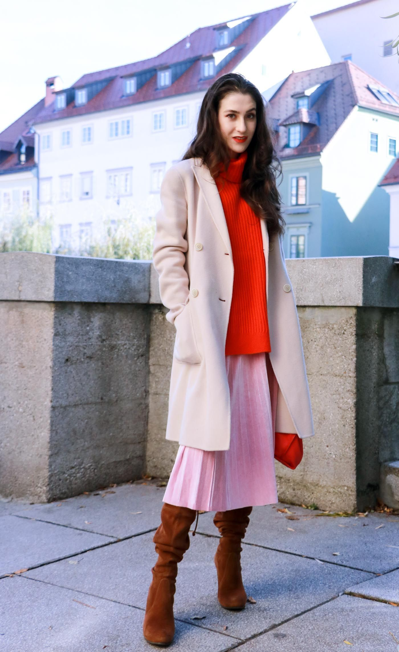 cceca116720f Fashion Blogger Veronika Lipar of Brunette from Wall walking around in pink pleated  velvet midi skirt, red oversized Ganni sweater, double breasted Weekend ...