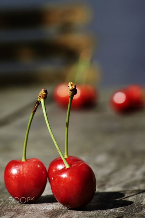 fresh cherries on wooden table by pbombaert  IFTTT 500px