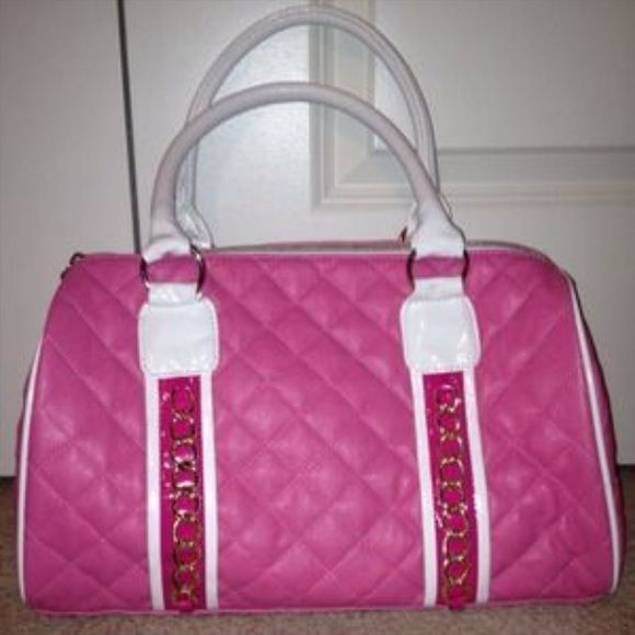 Nicky Minaj Pink Friday Duffle Bag Great duffle bag. Can be used for any purpose. Pink colored bag. Gold chain on front side. Inside is lined pink. Does have wear in tear Nicki Minaj Bags