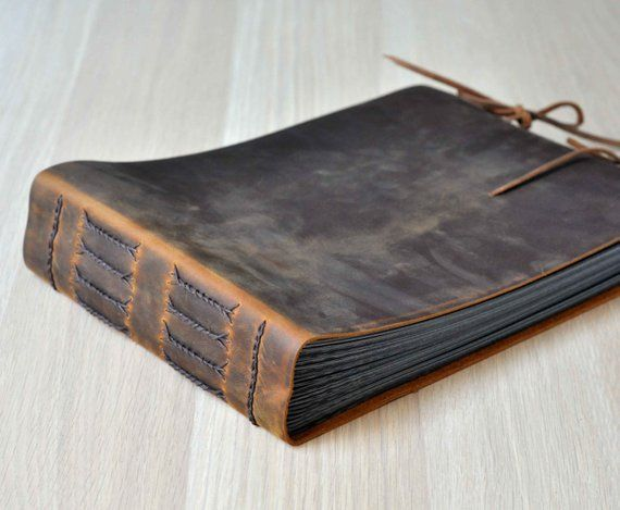 This Rustic Leather Album Is Handmade By Cowhide Leather