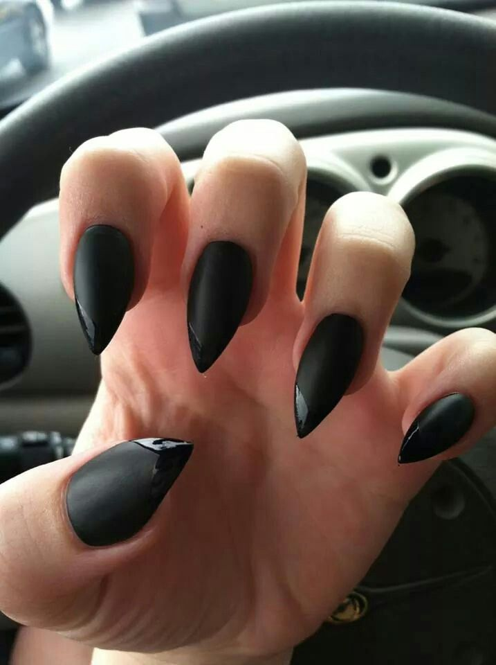Awesome goth stiletto nails! Looks like matte black nail polish with ...