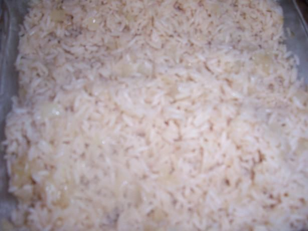 Oven Baked White Rice,  I'm doing this tomorrow.  Hope it works....  This recipe makes perfect rice every time, simply because the temptation to stir isn't there. This foolproof rice goes well with roasted chicken or broiled fish. I sometimes like to add a 1/2 cup of shredded carrots in addition to the onion to give it a flash of color.