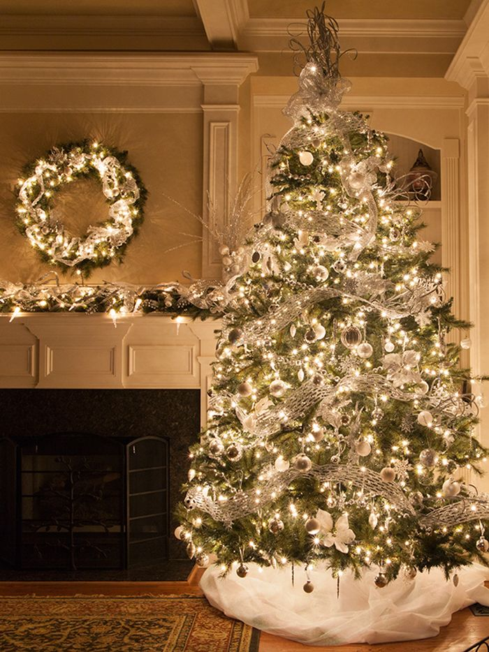 such an elegant way to decorate for christmas matching tree wreath and garland glow with white christmas lights just add silver and white ribbon - White Prelit Christmas Tree