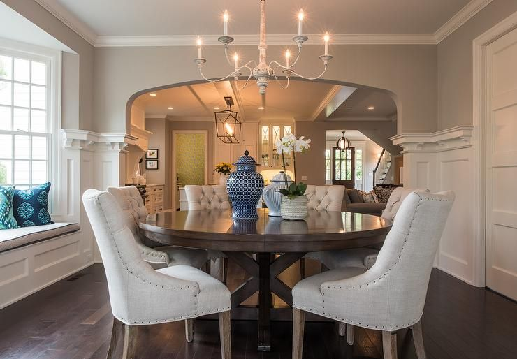 A Centerpiece In This Dining Room Is A Round Wooden Mahogany Dining Table With Gorgeous Bei Mahogany Dining Table Round Dining Room Table Informal Dining Rooms