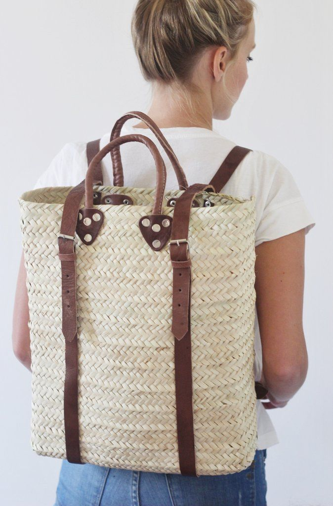 f0532f13ff5c A classic straw tote with a twist. Handmade in Morocco