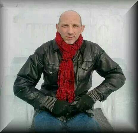 Warm Winter  Red scarf , black leather jacket , black gloves, and denim.