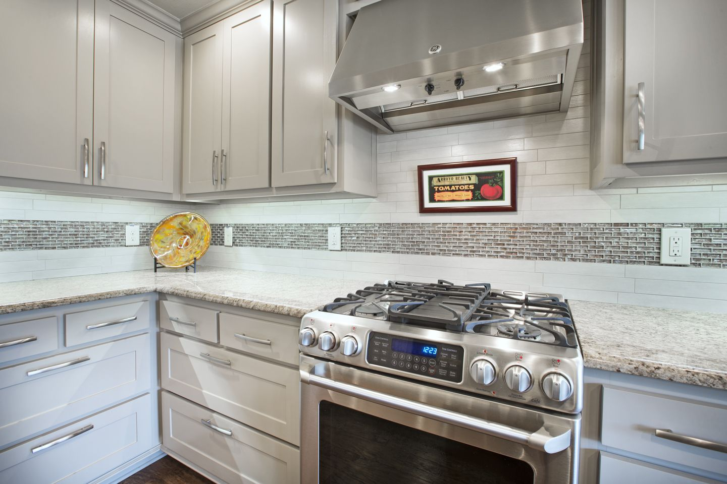 The New Kitchen Features Stainless Steel Appliances Beautifully