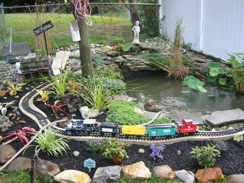 Toy train around a pond garry and sarah are going to go for Garden pond ideas for small gardens
