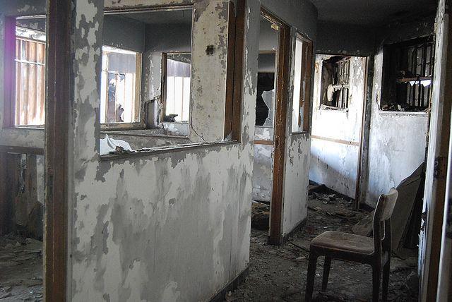 Once a Car Dealership, Detroit, via Flickr.  Sales rooms inside an abandoned car dealership in the Motor City
