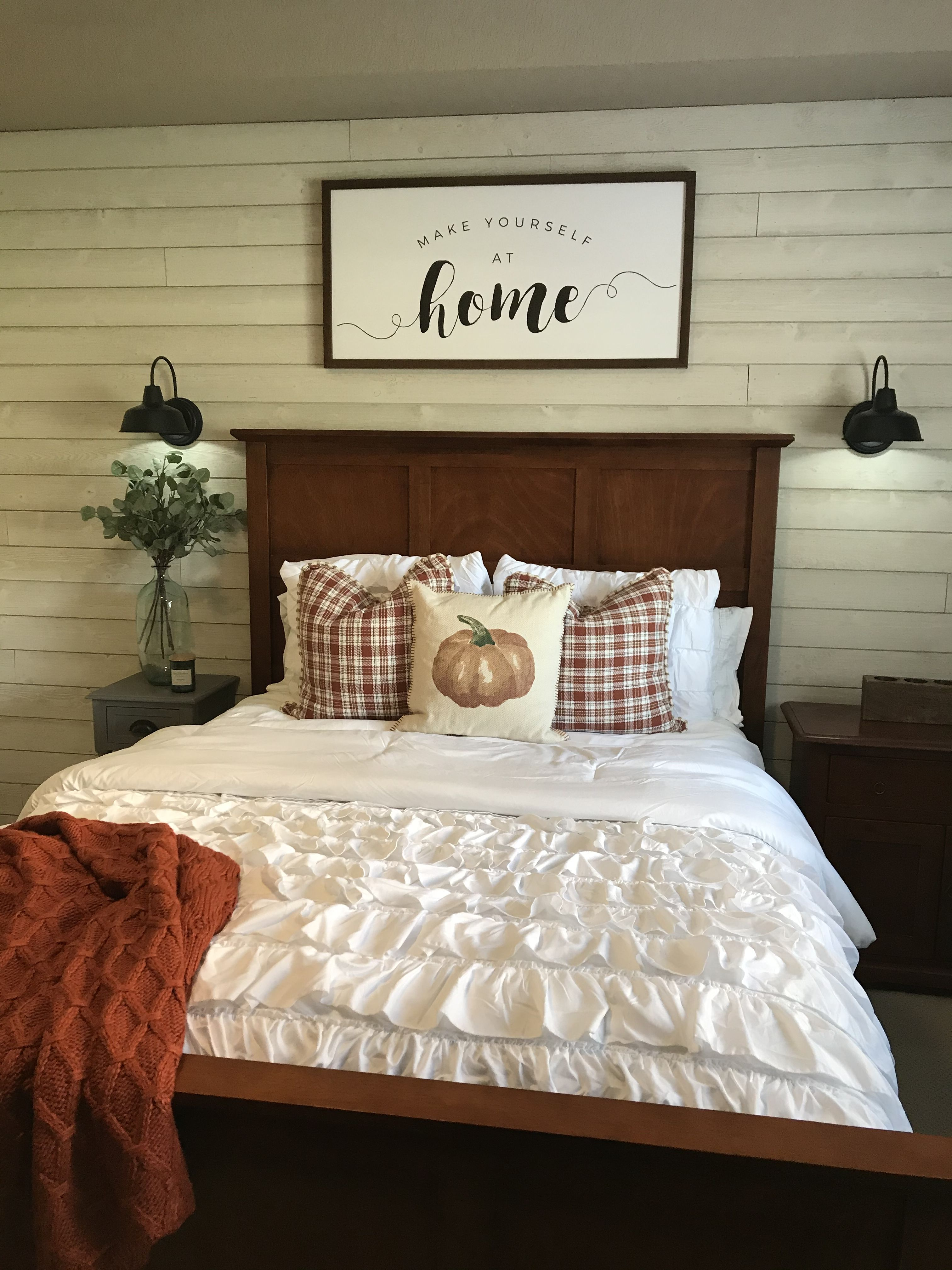 Shiplap wall, wireless sconces, comfy farmhouse decor