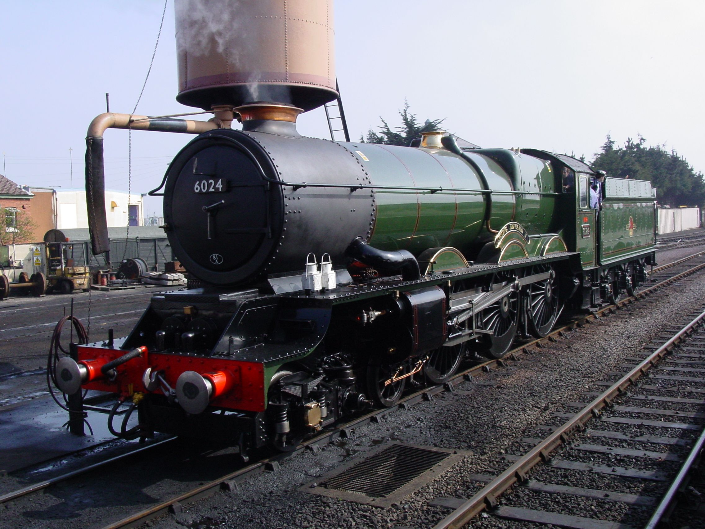 A GWR King in Minehead Station; Great Western Railway (GWR) 6000 Class 6024 King Edward I is a preserved steam locomotive. She ran from 1930 to 1962 for the Great Western Railway and latterly British Railways hauling express passenger services.