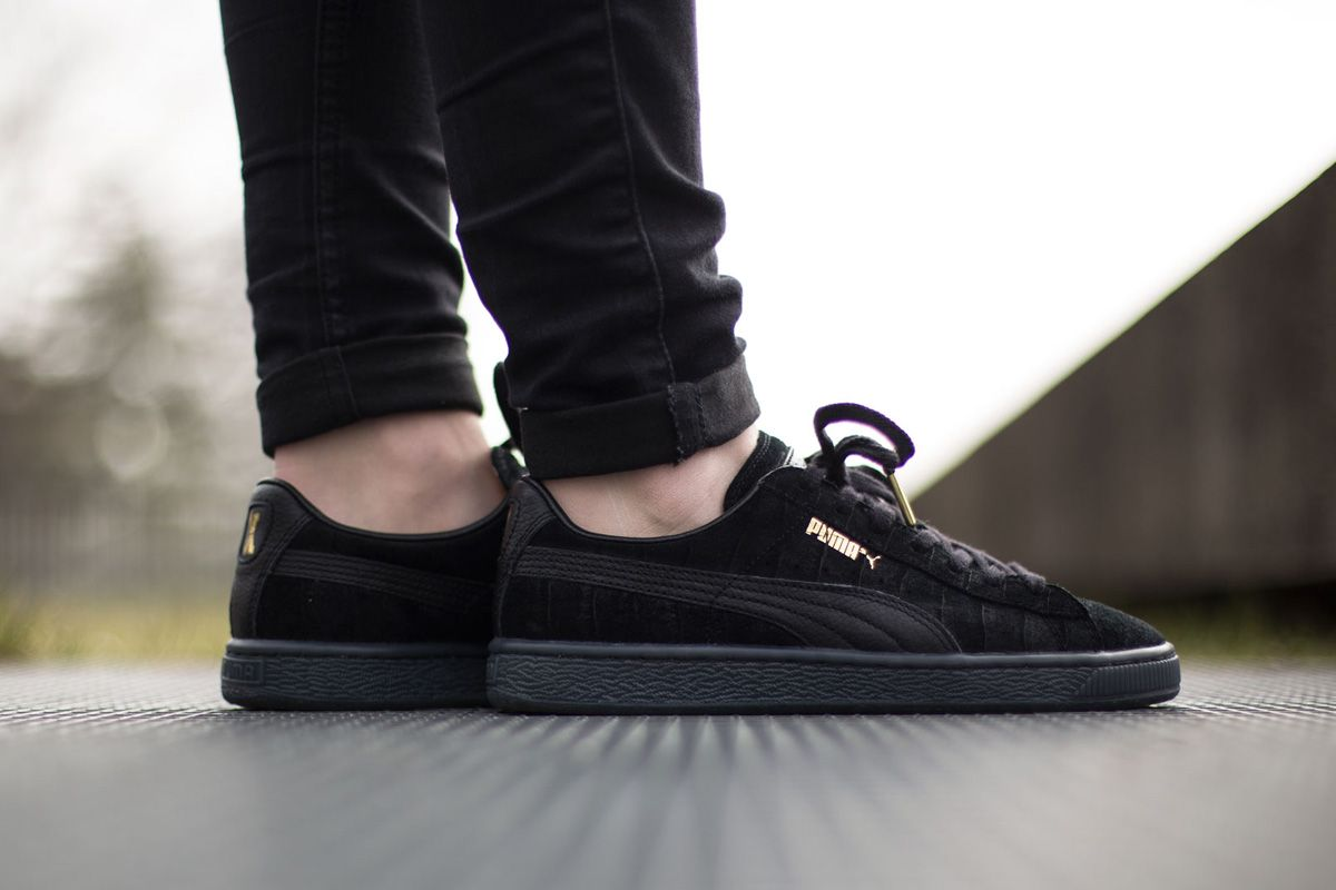 puma suedes on feet