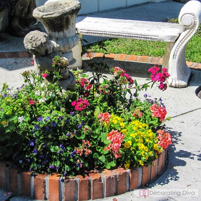 Circular Flower Garden Accented With Cherub Statue Holding Planter Urn. |  The Decorating Diva,