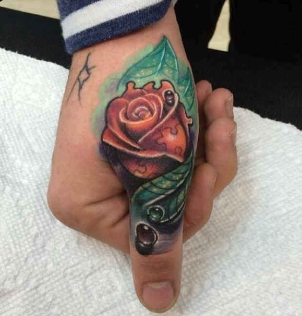 Tattoo Hand Colored Rose Ideas Rose Tattoos For Men Hand Tattoos For Guys Thumb Tattoos