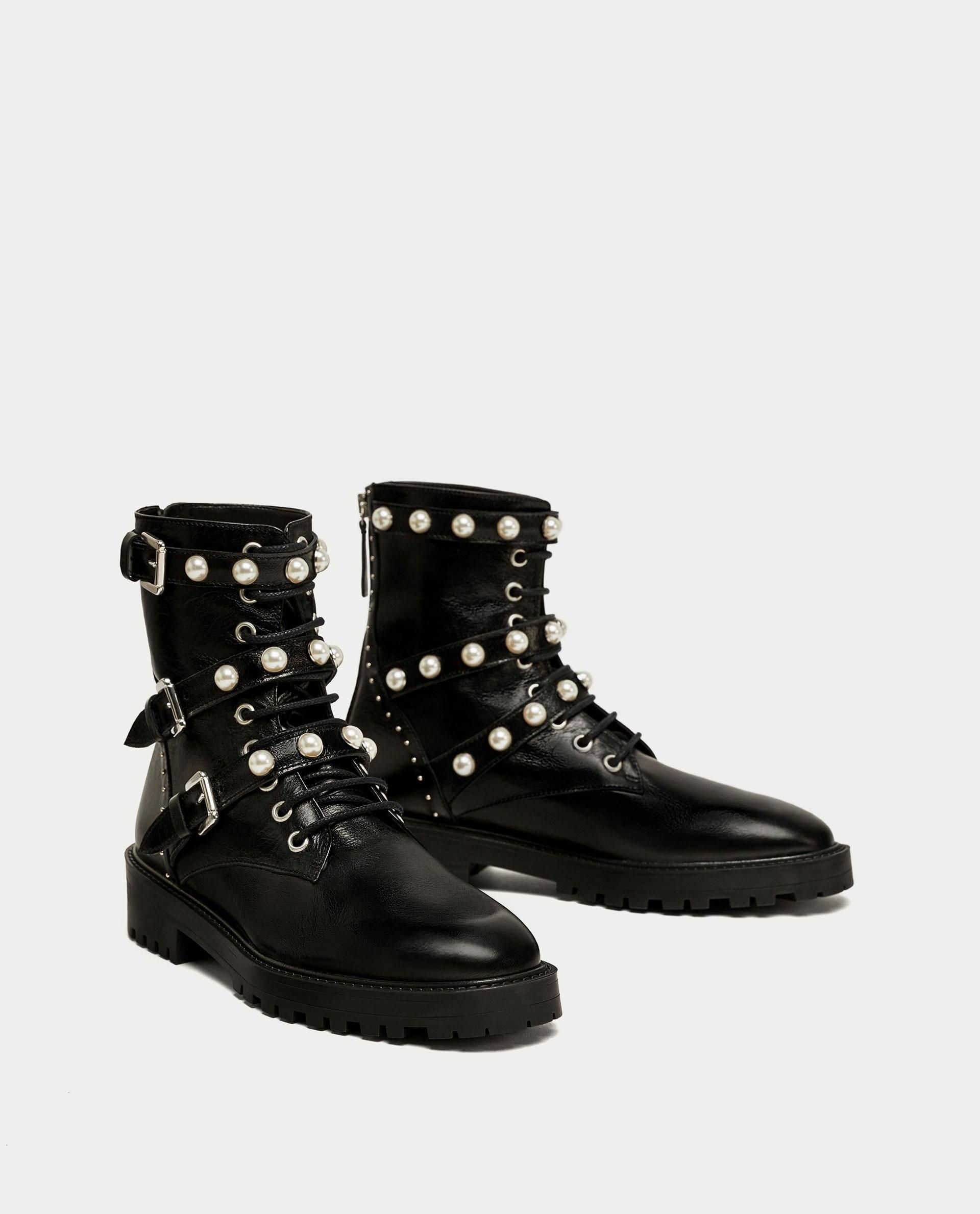 5c6737216 Leather Ankle Boots With Faux Pearls    119.00 USD    Zara    Black flat  leather ankle boots. Studs detail on the heel. Laces and straps with pearly  detail ...