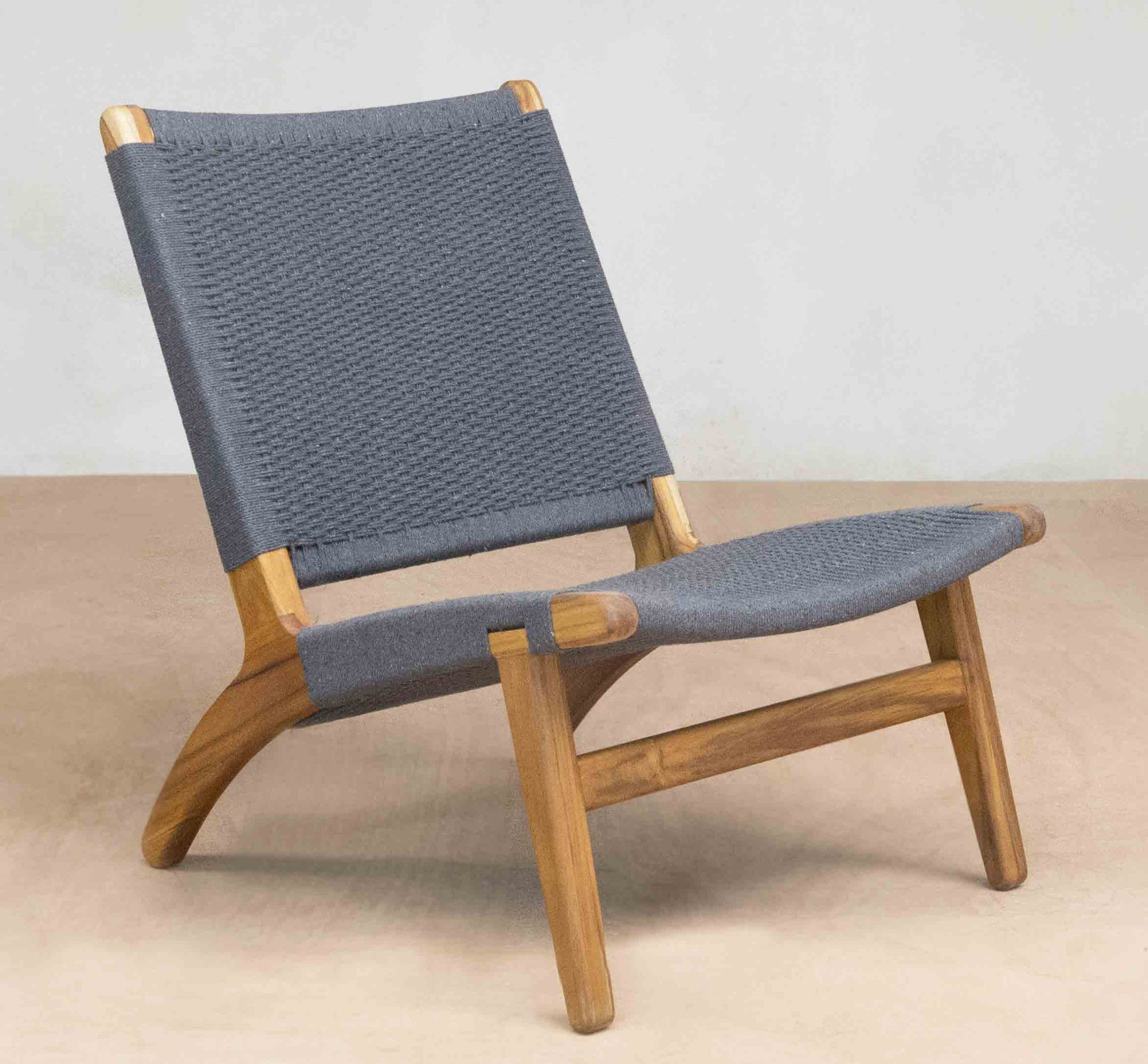 Modern lounge chair with hand woven charcoal grey manila cotton seat and handmade sustainably harvested hardwood frame a stylish modern living room chair
