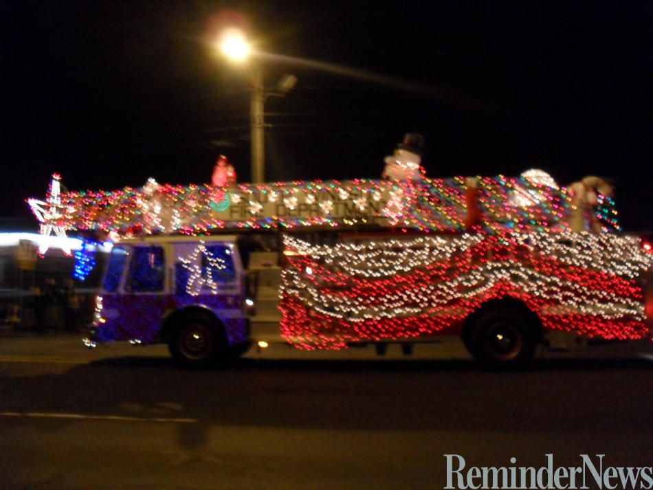An Enfield fire truck decorated with bright holiday lights for the ...