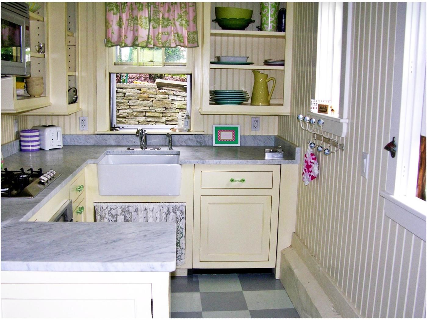 Nantucket cottage kitchen with stainless, marble and green
