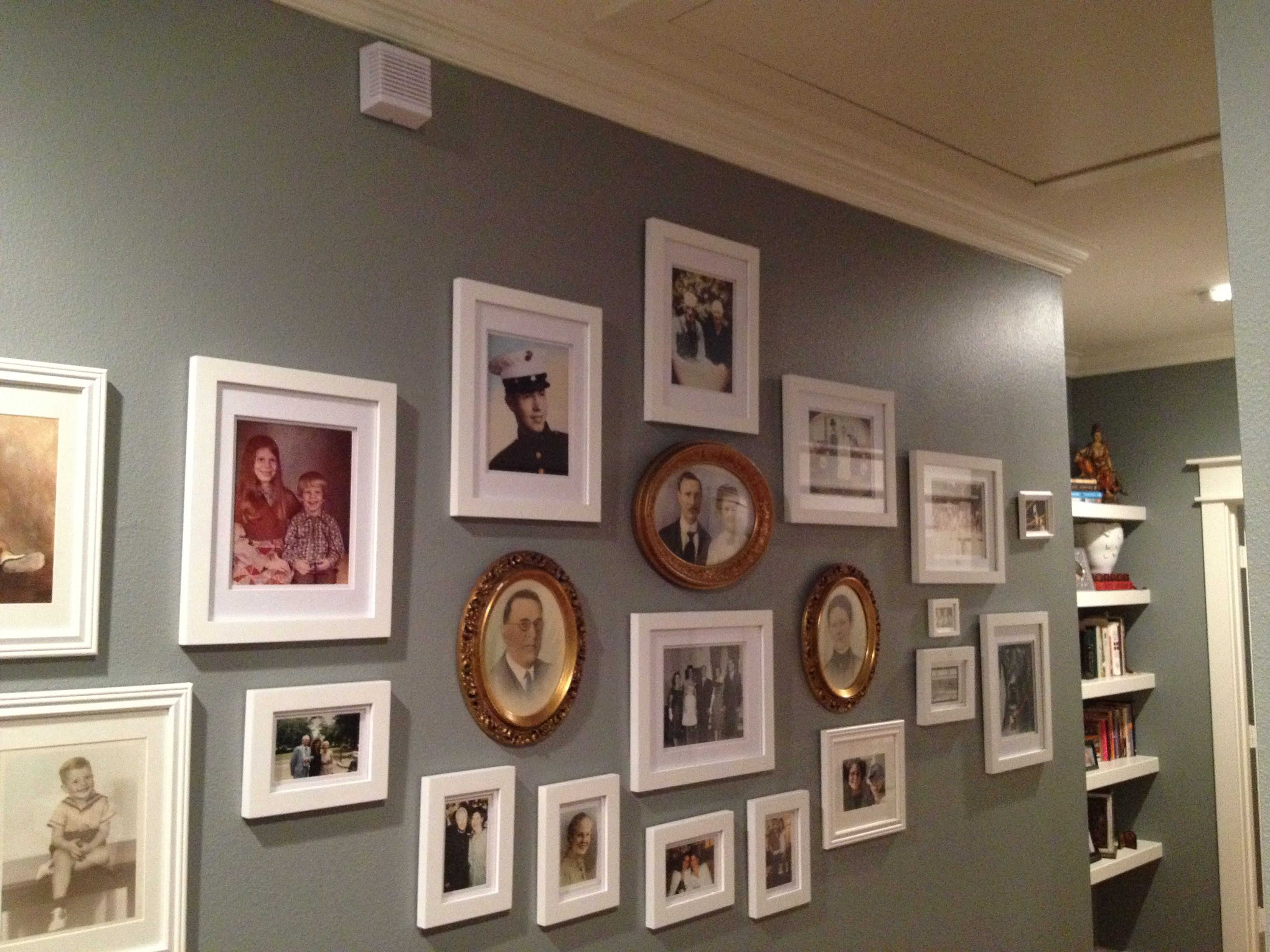 Wall decor using pics that span my lifetime - white frames with white mats mixed with old gold frames...still a work in progress.