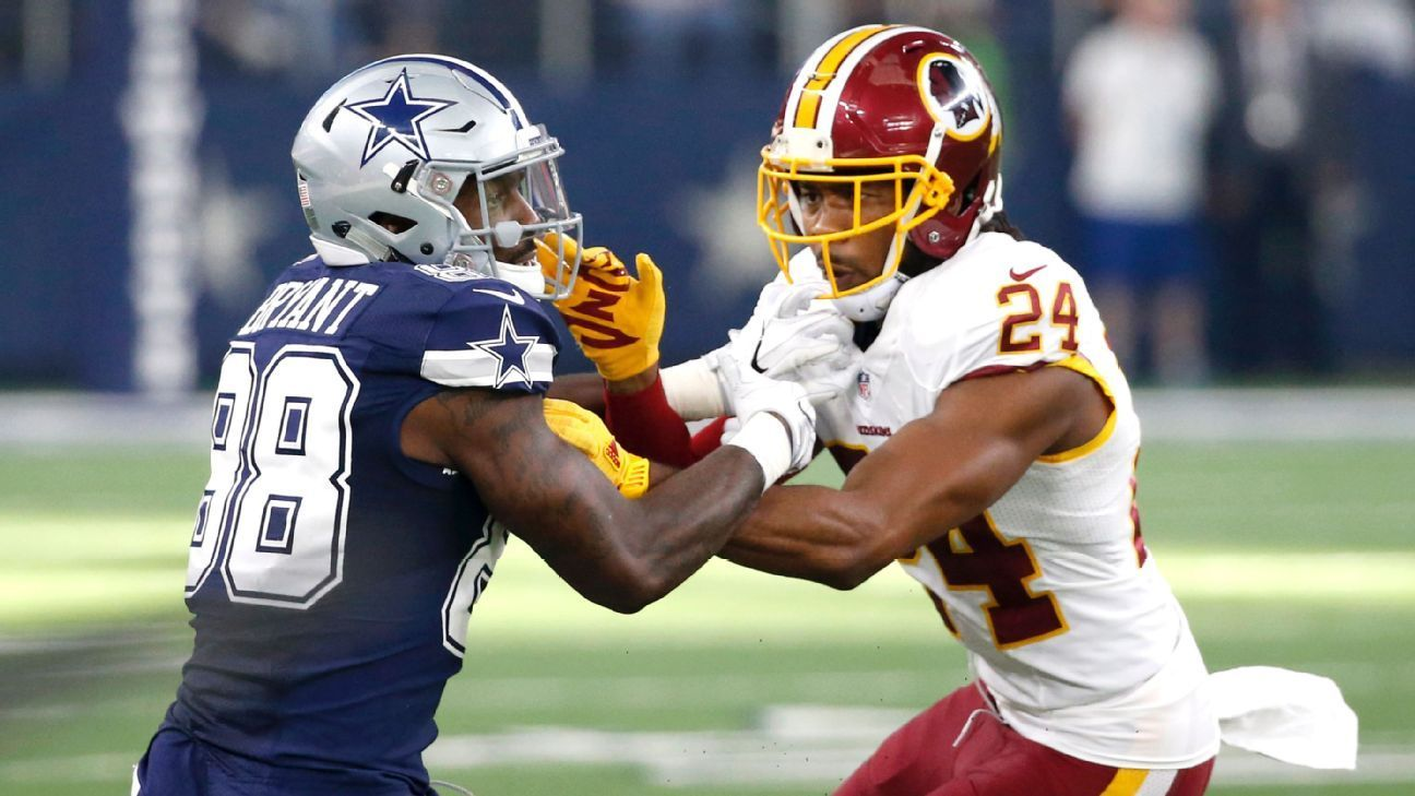 Bryant Norman clash during after Cowboys win