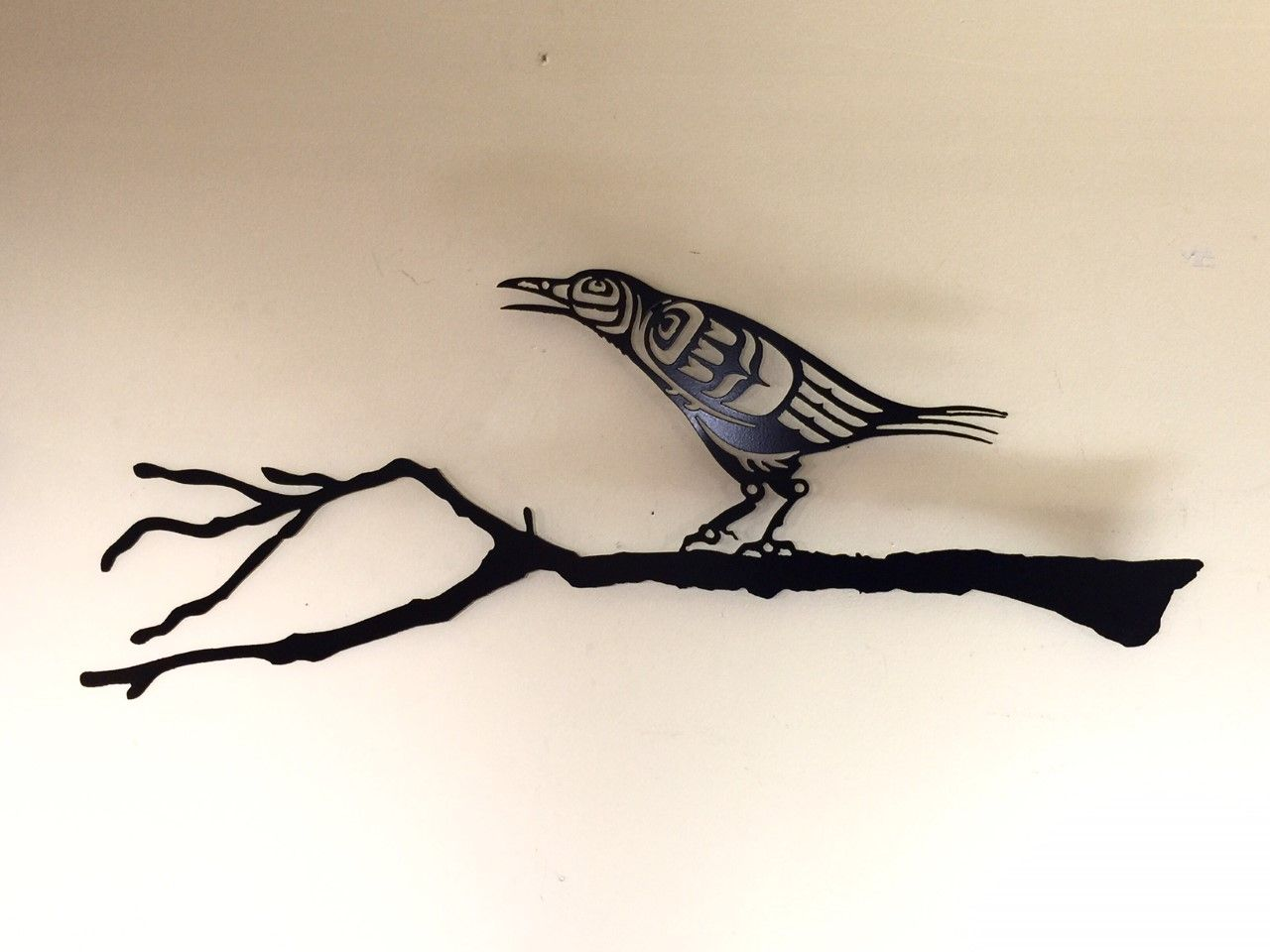 This Coast Salish Piece Of Steel Art Featuring A Crow On A