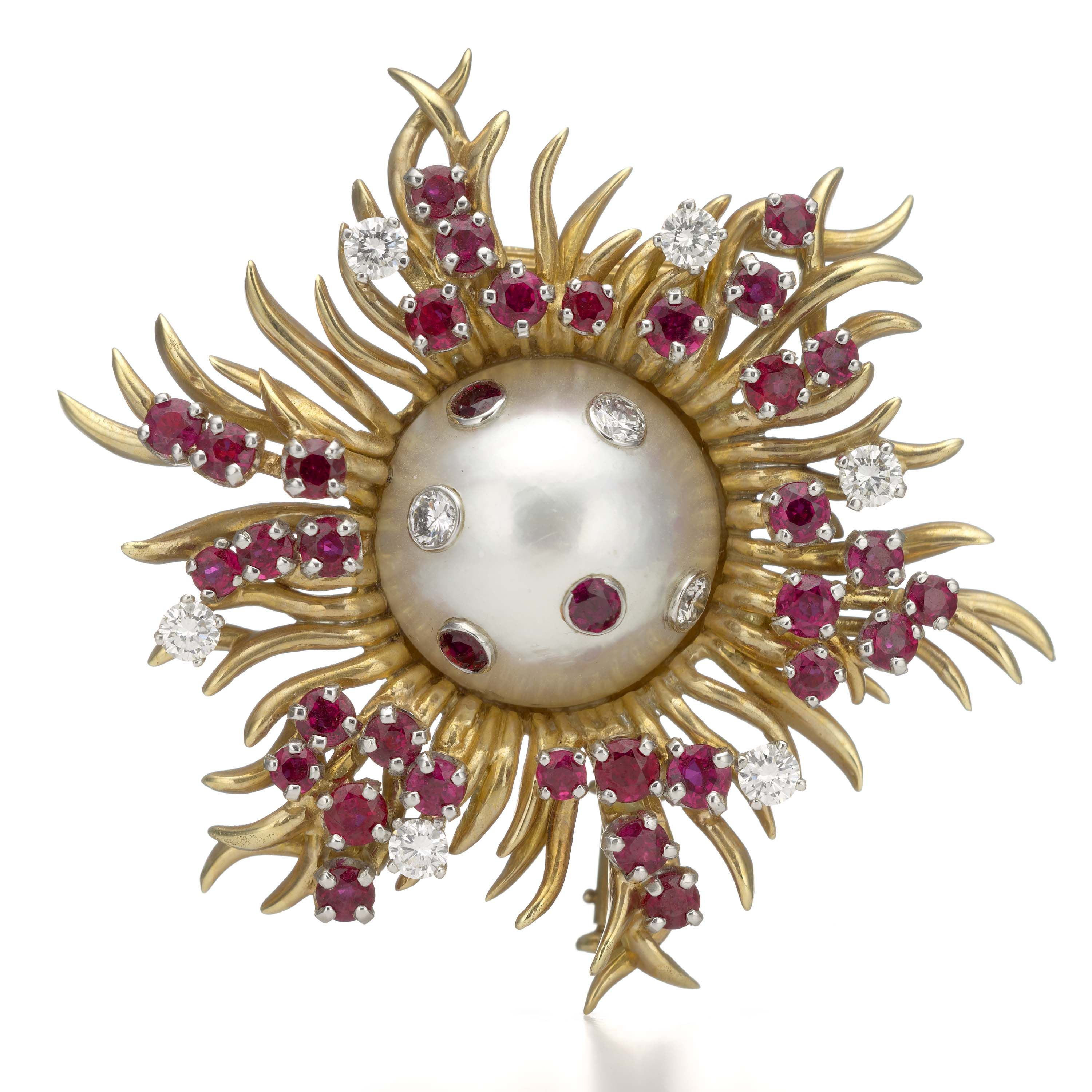 Starburst clip brooch by Schlumberger, Tiffany & Co., American, post–1956; made of gold, diamond, ruby, and mabe pearl.