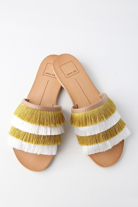 92b3aa70b68b Make a splash at the garden party in the Dolce Vita Celaya Yellow Fringe  Slide Sandals! Trendy yellow and white fringe covers the wide toe band of  these ...