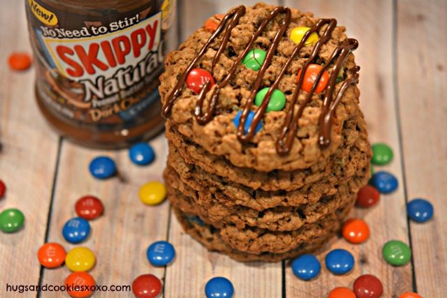 Gluten Free Dark Chocolate Peanut Butter Oatmeal M&M Cookies - By Danielle Baron from Hugs and Cookies XOXO. When she isn't teaching her first grade class, Danielle is baking cookies for her family and her blog. See how she amps up traditional oatmeal cookies.