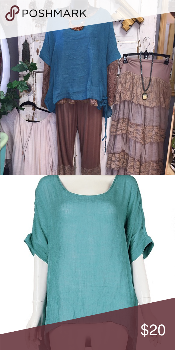Teal 2X Top Super cute sassy bling top, brown lace undershirt is not included, sold separately ... Top is adjustable on the sides and has a loose relaxed fit... One of my favorite pieces😍 sassy bling Tops Blouses