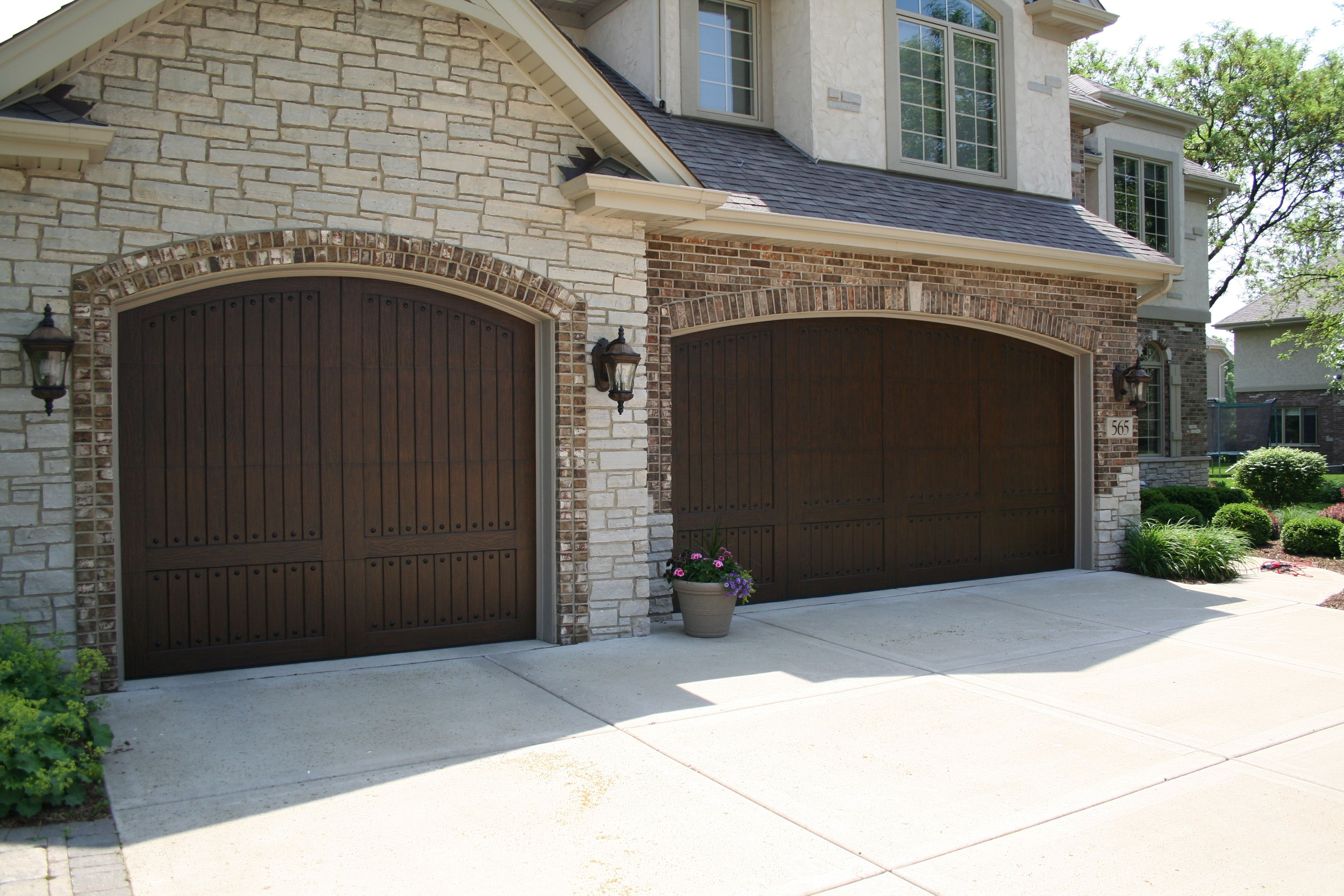 Carriage House Garage Doors Faux Wood French Country Style Garage Door Www Garagedo Carriage House Garage Carriage House Garage Doors Modern Bungalow Exterior