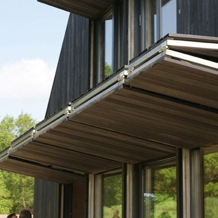 Hanger Doors Over A Bank Of Windows And Doors Fold Up Providing Shade From Sun Shelter From