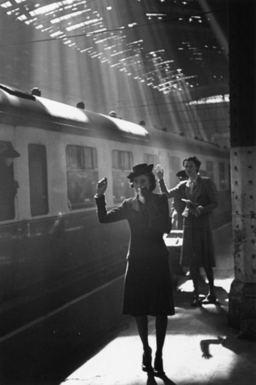 Tearful Goodbyes, Paddington Station, London, 1942.  I love the shadows and the light coming in from above.