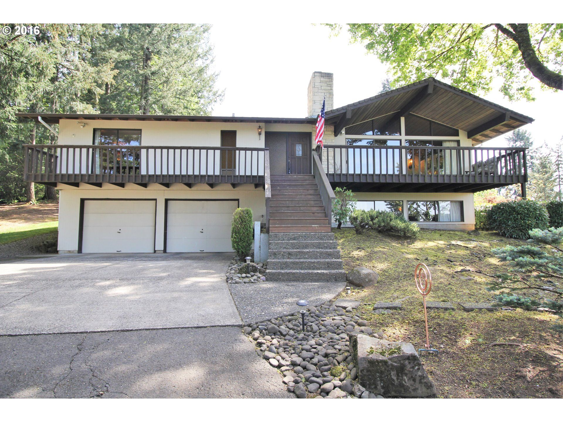 Period-Perfect Pick of the Week:  1969 Damascus (SE Countryside) Mid-Century Day Ranch with Wings! Time-Capsule home with original stone-work, marbled mirror tiled entry, kitschy swag lighting, shag carpeting, basement bar, original baths and kitchen, WOW! 4 beds, 3 bath, 3034 Sqft, 1.24 acres, oversized 2 car garage, $499,999. Listing courtesy of Oregon First.   17505 SE SUNNYSIDE RD, Damascus, OR 97089