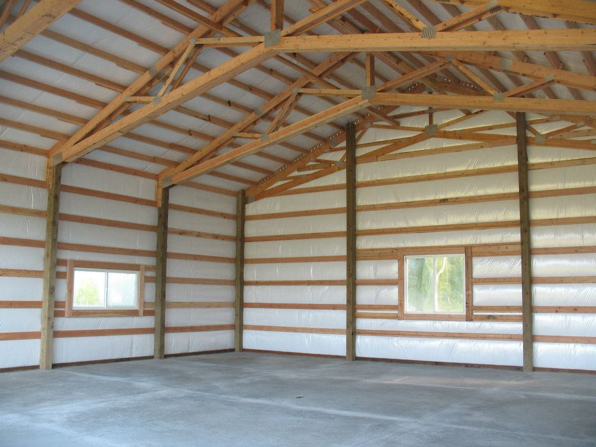 Interior of a post frame garage shop in stanwood wa for Metal building interior ideas