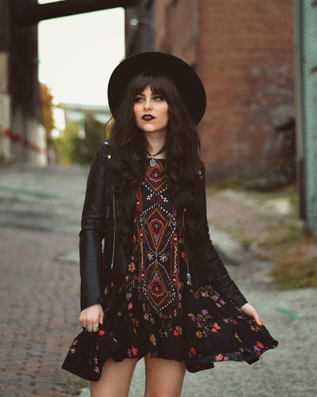 6a9d461fab17 Folksy dress, floppy boho hat, and leather biker jacket paired with dark  lips. Such a cool look!