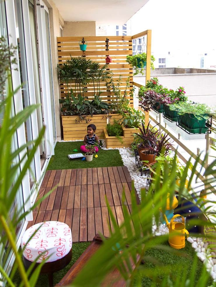 add a playful pallet wall to your balcony space to house your wall