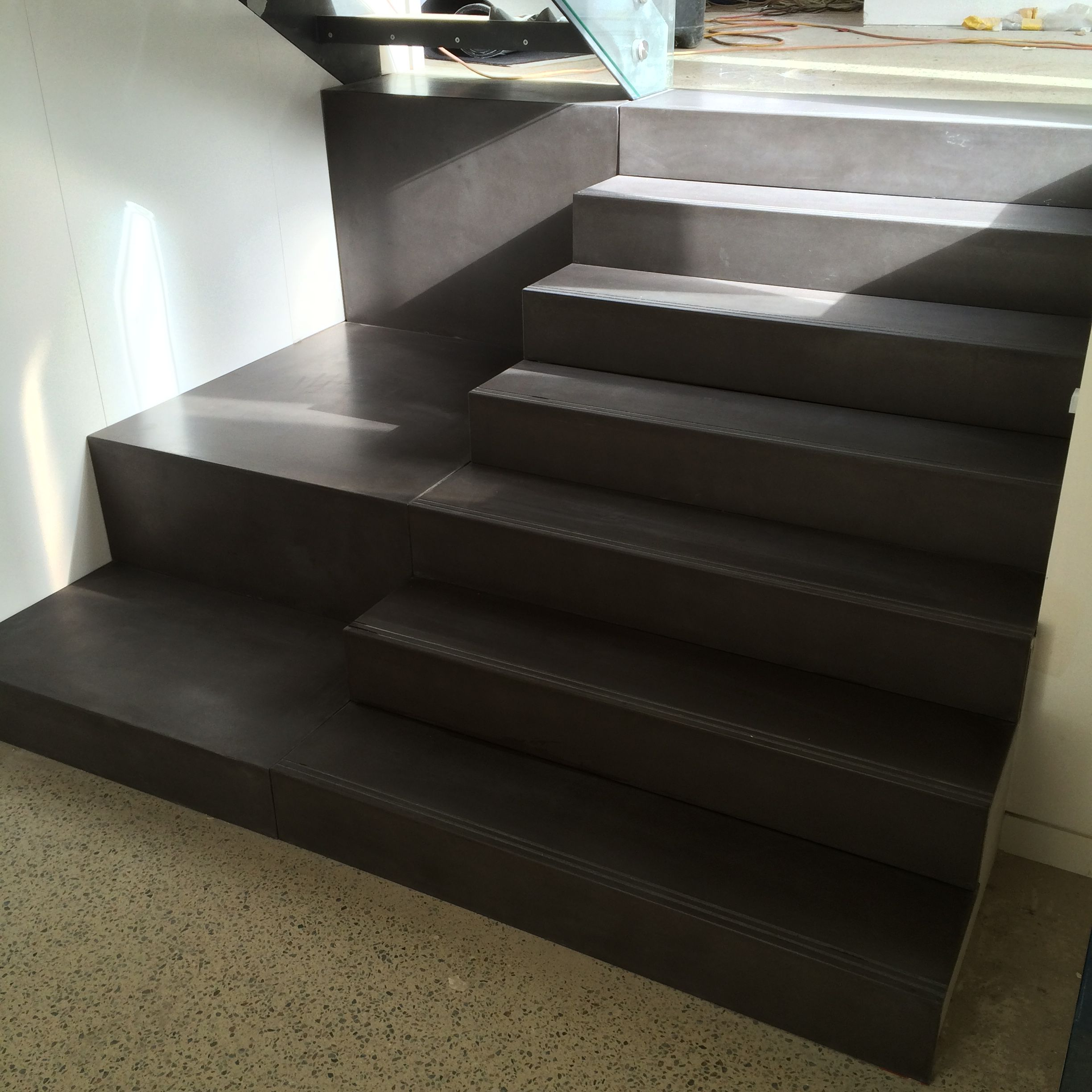 polished concrete staircase by mitchell bink concrete design