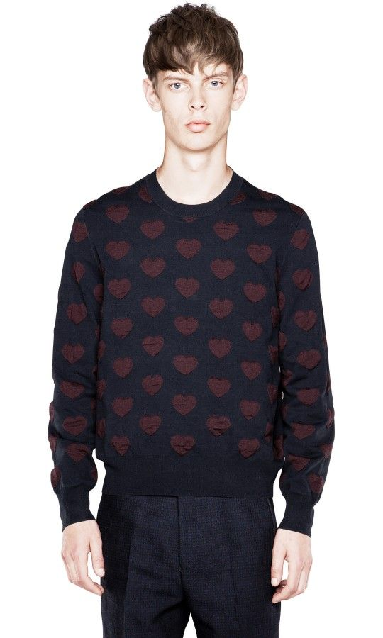 Adam Heart is an eye catching pullover sweater with repeating 3D intarsia hearts.