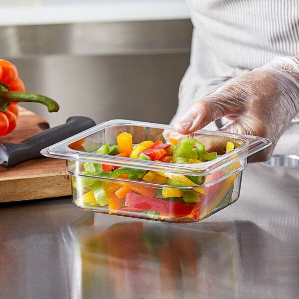 Add versatility to your kitchen with the help of this Vigor 1/6 size clear polycarbonate food pan. Made of durable polycarbonate, this pan can be added to your refrigerated prep tables or serve as a loose storage bin on your wire shelving. It's a versatile addition to your kitchen because it can be used to prep, store, transport, and serve food items. You can even use it in your steam table or at your salad bar! The polycarbonate material is virtually unbreakable and resistant to food acids and