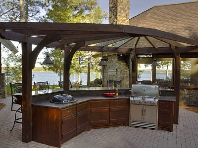 Outdoor bar & grill area features both a gas grill and charcoal ...